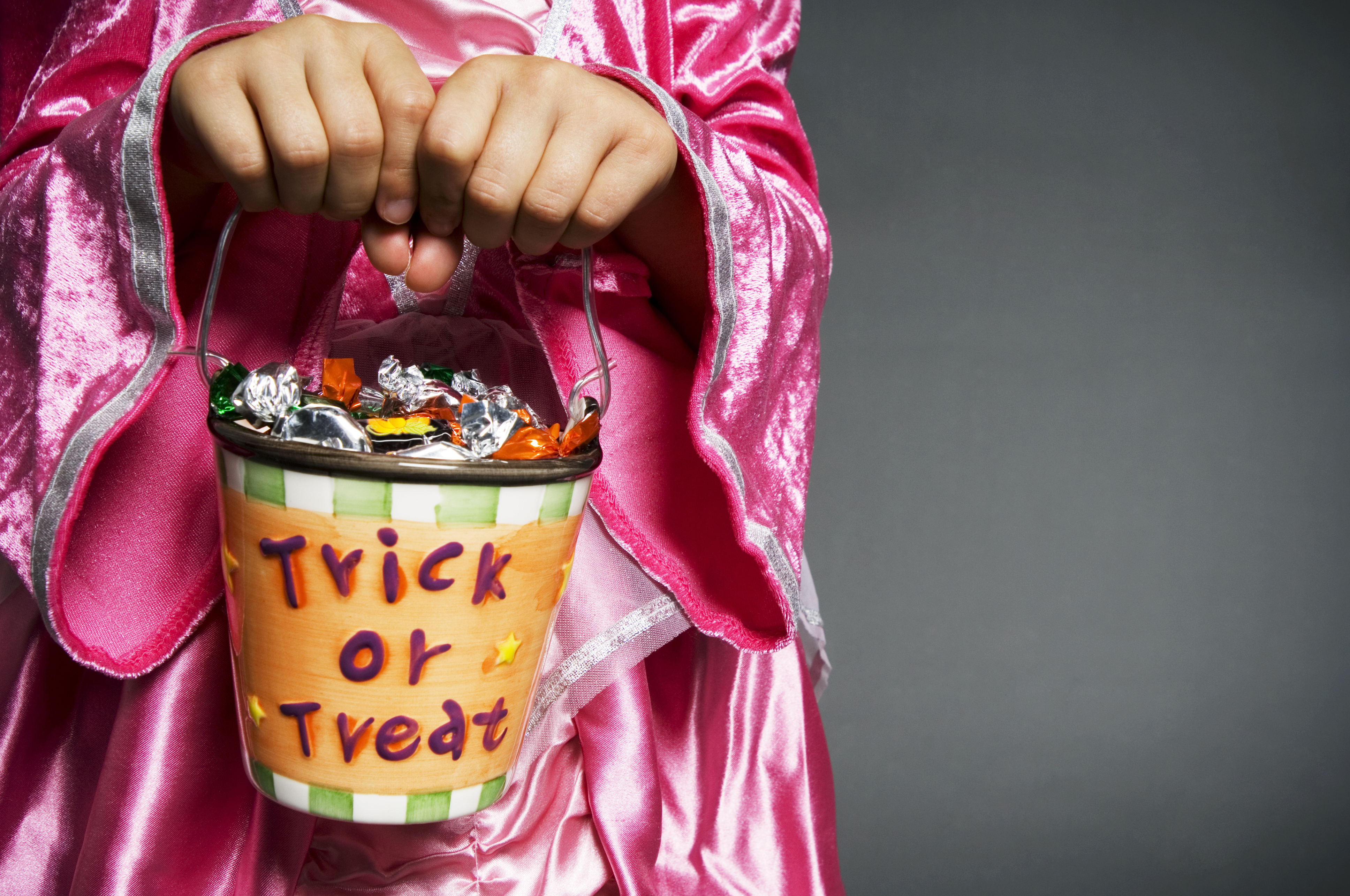 Girl holding Halloween trick-or-treat bucket