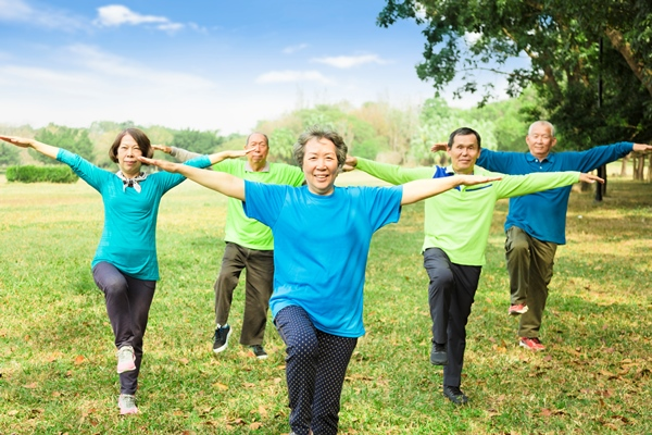 Seniors doing Tai Chi in a park